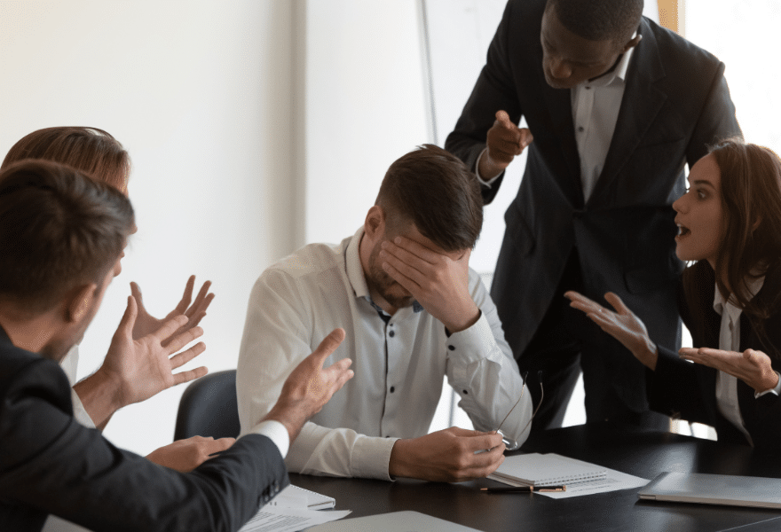Frustrated-employee-feels-stressed-suffers-from-hostile-coworkers