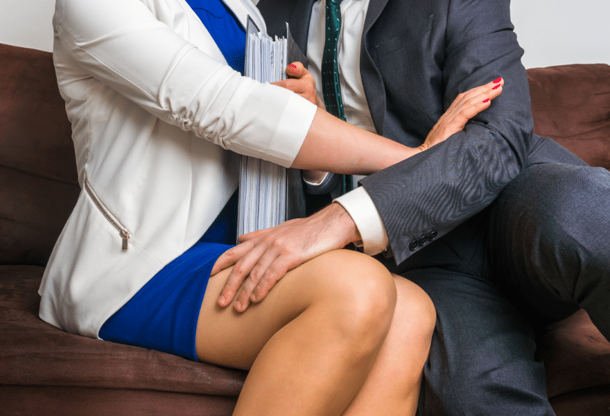 Man-touching-womans-knee-sexual-harassment-in-office