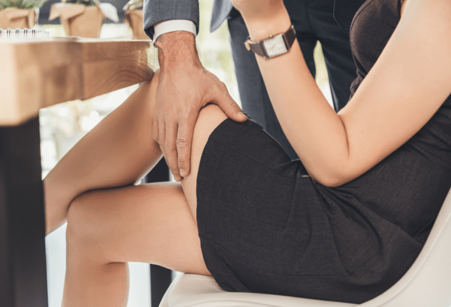 Supervisor-groping-employee-on-thigh-in-the-workplace